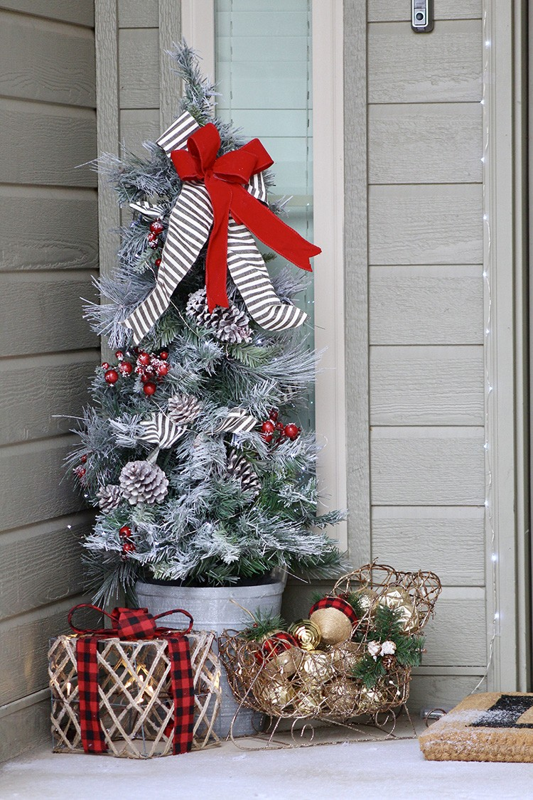 Ashley Basnight of Handmade Haven transforms her front porch for the holidays. Impress your guests with Christmas decorations from The Home Depot.