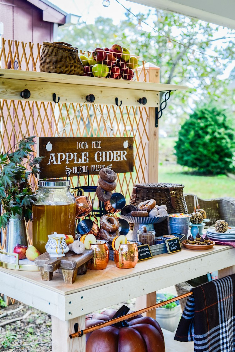 Jennifer Caroll of Celebrating Everyday Life builds a potting bench and styles it as an apple cider bar that any guest will compliment this fall season.